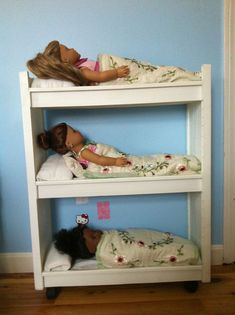 Two dollar thrift store CD tower repurposed as a triple bunk bed for American Girl dolls. We used a crib bumper as 'mattresses' and pillows. Oh maybe old crib remade into doll cribs. American Girl Crafts, American Girl Clothes, Girl Doll Clothes, Girl Dolls, Baby Dolls, American Girls, Diy Cat Bed, Cat Beds, American Girl Furniture