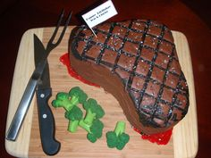 Steak Cake Steak cake made of homemade oatmeal protein muffin mix dyed and filled with strawberry. Chocolate icing with painted grill marks...