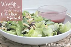 Wendy's Copy Cat Apple Pecan Chicken Salad Recipe  1 bag of Romaine Lettuce, 1 apple cut into chunks or grated, ¼ cup dried cranberries, ½ cup cubed cooked chicken breasts, ¼ cup blue cheese crumbles, ¼ cup honey roasted pecans or almonds