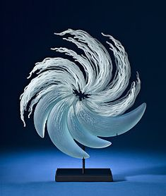 Maelstrom Glass Sculpture  by K. William Lequier His current artistic form is making organic sculptures carved in relief from blown glass forms.