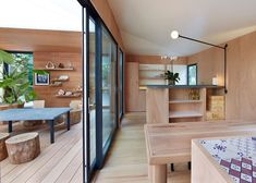 ply pelmut above sliding doors  Louis Vuitton builds Charlotte Perriand beach house at Design Miami