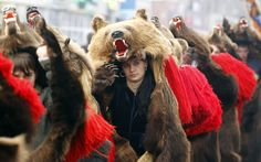 Dancers from Romania's northeastern region of Moldova perform the bear dance, a ritual for good luck in the New Year, during a traditional parade in Comanesti, 300 km northeast of Bucharest.