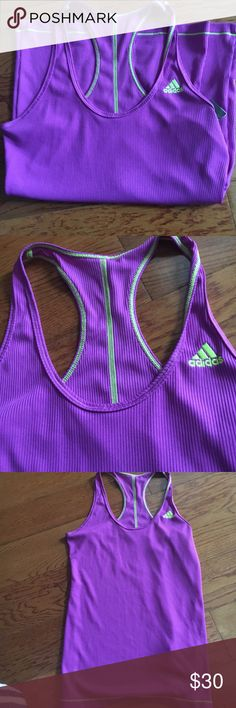 Adidas workout tank Size medium adidas racer back tank with green embroidery and emblem. Ribbed material never worn. Very sillky soft fabric Adidas Tops Tank Tops