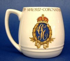 This lovely ceramic mug was created by Booths, England for the coronation in 1937 of King George VI and Queen Elizabeth who are the parents of Queen Elizabeth II of England. The mug is 3.5 inches high