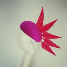Pink velvet hat with red feather mowhawk. www.edelrambergdesigns.ie