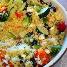 "Party-Size Greek Couscous Salad | ""Great for picnics or large gatherings. Made (for 50) the night before, left in fridge overnight and added salad dressing before serving. """