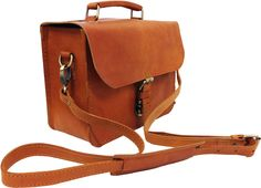 Travel with a very nice Vintage - Retro look with long shoulderstrap . Available on our Etsy shop: https://www.etsy.com/nl/listing/222819607/leren-schoudertas-in-cognac-blank-kleur?