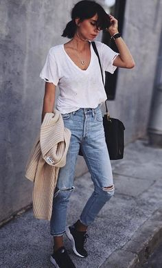 A classic ripped jeans and tee look never goes out of style. | Learn 9 Secrets to Enhance your Streetwear Style