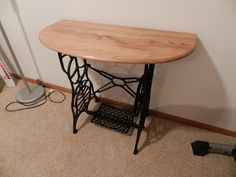 Antique sewing machine base, top custom made by my husband of red elm from my parents' land.