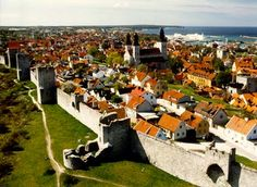 Visby on the island Gotland in the Baltic Sea. There are archeological findings that says that Visby existed 1400 years ago. The town wall is from the middle ages.