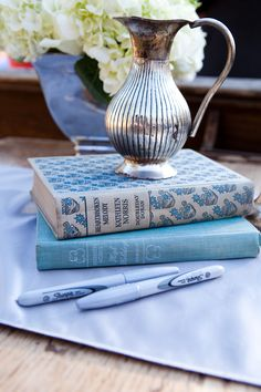 Southern Vintage Rentals  - vintage books and silver pitcher