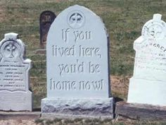 Headstone in a cemetery photo, picture of crazy weird gravestone  tombstone in a creepy cemetery with a funny epitaph if you lived here you'd be home now engraved in the grave marker for Halloween entertainment.