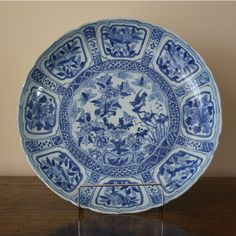 A Large Late Ming Kraakware Dish, Chongzhen Period (1627-1644) c.1640. The Barbed Saucer Shaped Dish Decorated in Blue and White with Peony and Daylily Issuing From a Scholar`s Rock. The Cavetto with Typical Kraak Panels of Birds.
