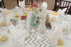 Table setting at Concordia University's Earhart Manor with chevron runners and flowers from Pot & Box