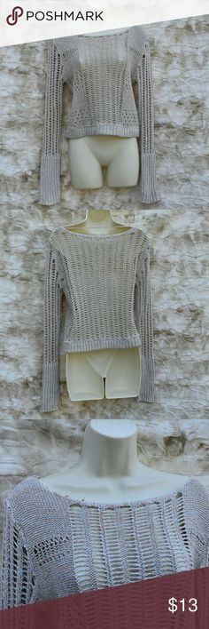 Free People Crocheted Sweater Free People brand, loose crocheted cream with light pink and light blue accents throughout. Has a flaw as pictured in photo 3 on the neckline could still be worn or fixed. Price reflects flaw. Free People Sweaters Crew & Scoop Necks