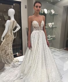 A gorgeous mix of a bold, modern neckline and a classic, princess-worthy skirt on this @bertabridal wedding dress.