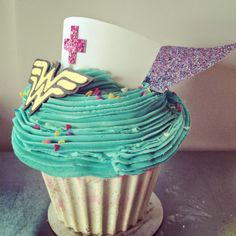 Giant Wonderwoman cupcake for #NICU nurses! With a sparkly cape and a nurse's hat ♥ by #amandacupcake