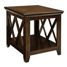 """Hardwood end table with lattice detailing and a bottom display shelf.   Product: End tableConstruction Material: Oak veneers and solid hardwoodColor: Dark tobacco Features: Bottom display shelfOpen latticework sides Exposed tendon joinery Square block legs Burnished and distressed finish Chamfered undertop moldings   Dimensions: 24"""" H x 22"""" W x 25"""" DCleaning and Care: Wipe with soft cloth   Assembly: Assembly required. No tools necessary."""