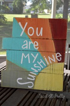 "Bright, colorful You Are My Sunshine on reclaimed wood pallets from Paintitprettyafwife on etsy.com. This would be an adorable wall quilt (to go along with the other one I have pinned that's ""You make me happy when skies are gray."")."