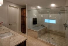 tub and shower side by side | In a large bathroom, you can put the tub inside a spacious shower