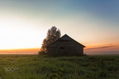 Mist And Barn Houses - The mist rises from the fields of the Northern Finland on a summer night and gradually covers the old barn houses.
