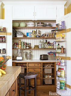 All the chaos of the kitchen is hidden behind closed doors, which open to reveal an expansive pantry.