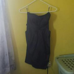 Little Black Dress Black strapless dress with POCKETS! Can't resist a dress with pockets!! Silky material with bow tied in the back. Worn a few times but still in excellent condition!!  No trades but willing to negotiate!! Deb Dresses Strapless