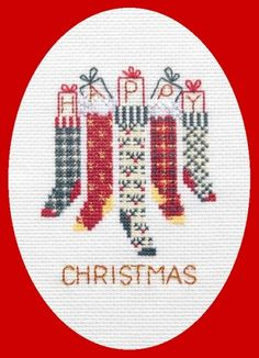 Traditional Christmas stockings on a cross stitch greetings card.