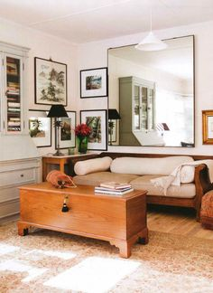 Living Room: Love the Bookshelf, the Frame Placement, the Lamp, the Couch & the Giant Mirror.