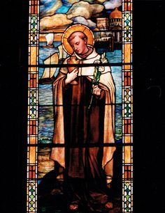 St. Albert of Trapani (1250-1307) at Philadelphia Carmel.  St. Albert wrote the Rule for the Carmelite Order.  Teresa of Jesus and John of the Cross would have both prayed to St. Albert for intersessions. He was one of the first saints of the order to be venerated. He is represented here with a lily, a symbol of purity and an urn for water he had blessed. Water is still blessed with his relics and the Carmel and is used for healing the sick. from The Chapel of the Holy Spirit booklet