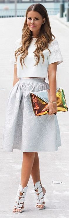 Chic Top with Grey Knee Skirt and Gold Clutch Purs...