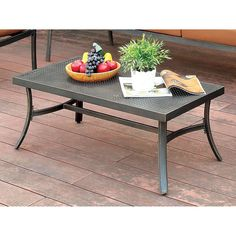 A soft yet durable addition to any outdoor seating area, this contemporary coffee table is a beautiful and convenient accent. The distressed black…