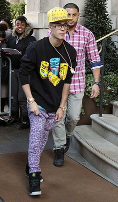 "Oh, that Justin is such a prankster! He busted a serious sag in purple leopard-print pants, a yellow studded hat, and a lot of other LMFAO-inspired nonsense in what appeared to be a joke. ""Ryan said you won't go out in that. I said watch mea haha,"" he captioned the Instagram pic. (2/27/2013)"