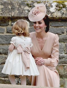 """Catherine, Duchess of Cambridge smiles at her daughter during the wedding of Pippa Middleton to James Matthews // May 20, 2017 """