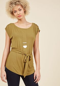<p>As you go about your day in this simple, yet sweet shirt, onlookers see you for what you are - a stylista and a sophisticate. Part of our ModCloth namesake label, this super-soft top relies on its mossy olive hue, decorative shoulder buttons, and self sash to let it stand out from the norm. And, succeed it does!</p>