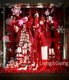 This six-foot tree is comprised of gift boxes and Sony gifts. Overhead, a mechanical conveyor belt traveled around the window displaying gifts.View Image Details