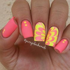 An eye catching combination of matte and water marble nail art design using salmon, and bright yellow nail polishes.