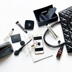 Perfect black and white flatlay - great for a whats in my bag - The arrangement is great too almost like a spillage from a bag if you could get it to be perfect!