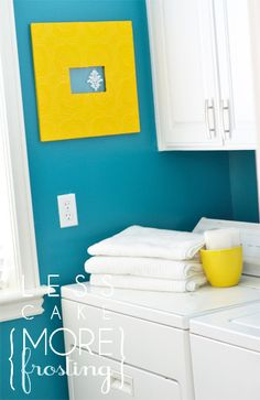 super cute laundry room love the teal blue and bright yellow