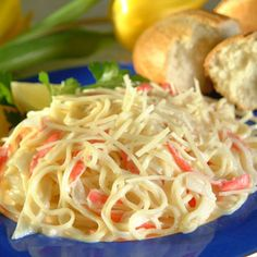 Angel Hair Pasta and Crab With Alfredo Sauce  - make w/ gluten free pasta and half the alfredo sauce