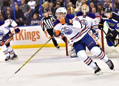 08 October, 2015:  Edmonton Oilers rookie center Connor McDavid (97)      skates after a loose puck in the third period during an NHL game between the Edmonton Oilers and the St. Louis Blues at Scottrade Center in St. Louis. The Blues won, 3-1. (Photo by Keith Gillett/Icon Sportswire)