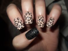 Leopard print with matte black leopard accent nail. Love this!