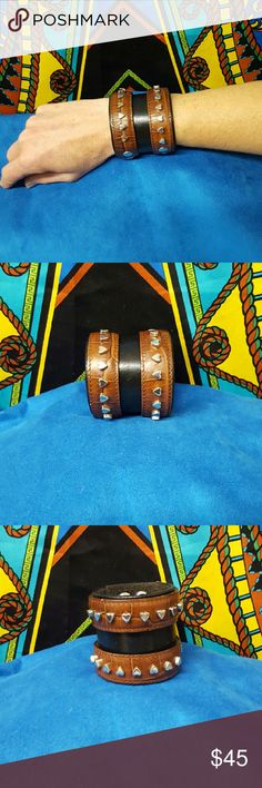 NEW ONE OF A KIND HAND MADE LEATHER WRIST CUFF NEW ONE OF A KIND DESIGN HAND MADE LEATHER WRIST CUFF. Layered brown and black leathers with heart stud embellishments. Rustic modern style. Bohemian Cowgirl Collection!! 2 snap options. Crystal's Cuffs Jewelry Bracelets