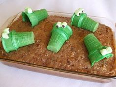 "Cute alligator cake... could also have brownies underneath instead; it would look fun with all the brownie ""cracks."""