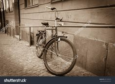 http://www.shutterstock.com/pic-201769373/stock-photo-classic-vintage-retro-city-bicycle-in-stockholm-sweden.html?src=z1Js5wc…