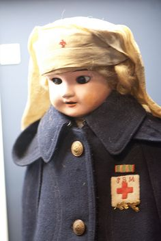 "Military Nurse doll (I think this is a super creepy doll with evil eyes. ""I'm watching you sleep so I can come to life...muhahahaha!""  Yikes.)"