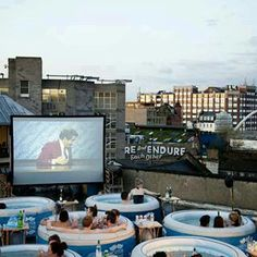 ~ re-vamp your back yard with a projector screen.. blow up family sized pool.. & a table for drinks/snacks on the side! Love it