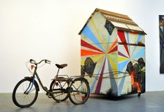 Erik Otto Slow Journey (phase 1)  house paint, spray paint, reclaimed wood, caster wheels, rope and found tricycle 4 x 8 x 7 ft. 2010