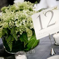 All-green arrangements of mini hydrangeas, orchids, button mums, berries, gerbera daisies and foliage decorated the tables.