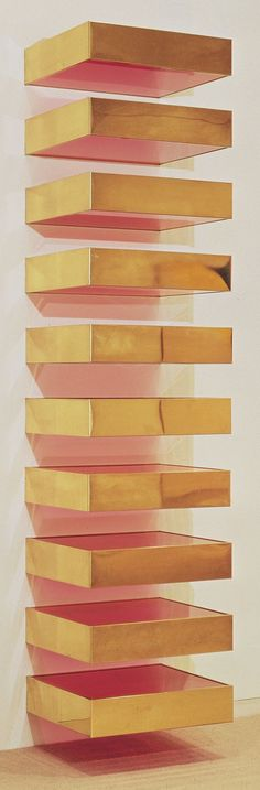 Untitled (1969) by NYC-based minimalist sculptor Donald Judd (1928-1994). Brass and colored fluorescent Plexiglas on steel brackets. 6 1/8″ x 2′ x 2′ 3″ collection Hirshhorn Museum and Sculpture Garden, Washington, D.C. via une petite menangerie